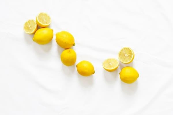 Bunch of lemons and lemon halves