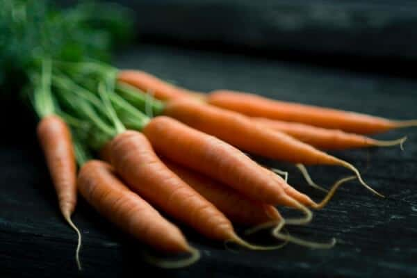 Fresh carrots on table