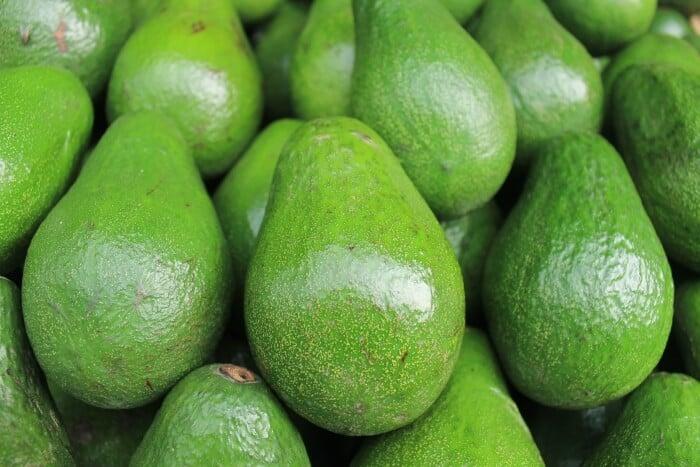Bunch of green avocados