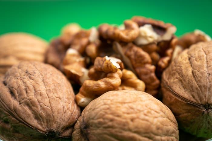 Unshelled walnut chunks closeup