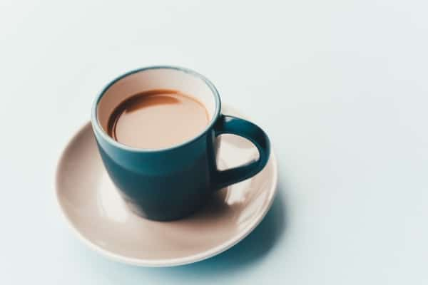 Blue cup with coffee